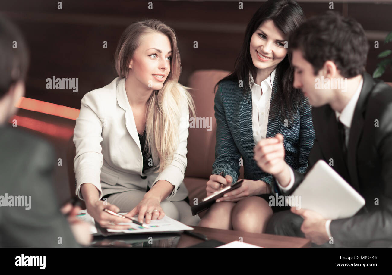 group of successful businessmen. To discuss an important issue with our partners - Stock Image