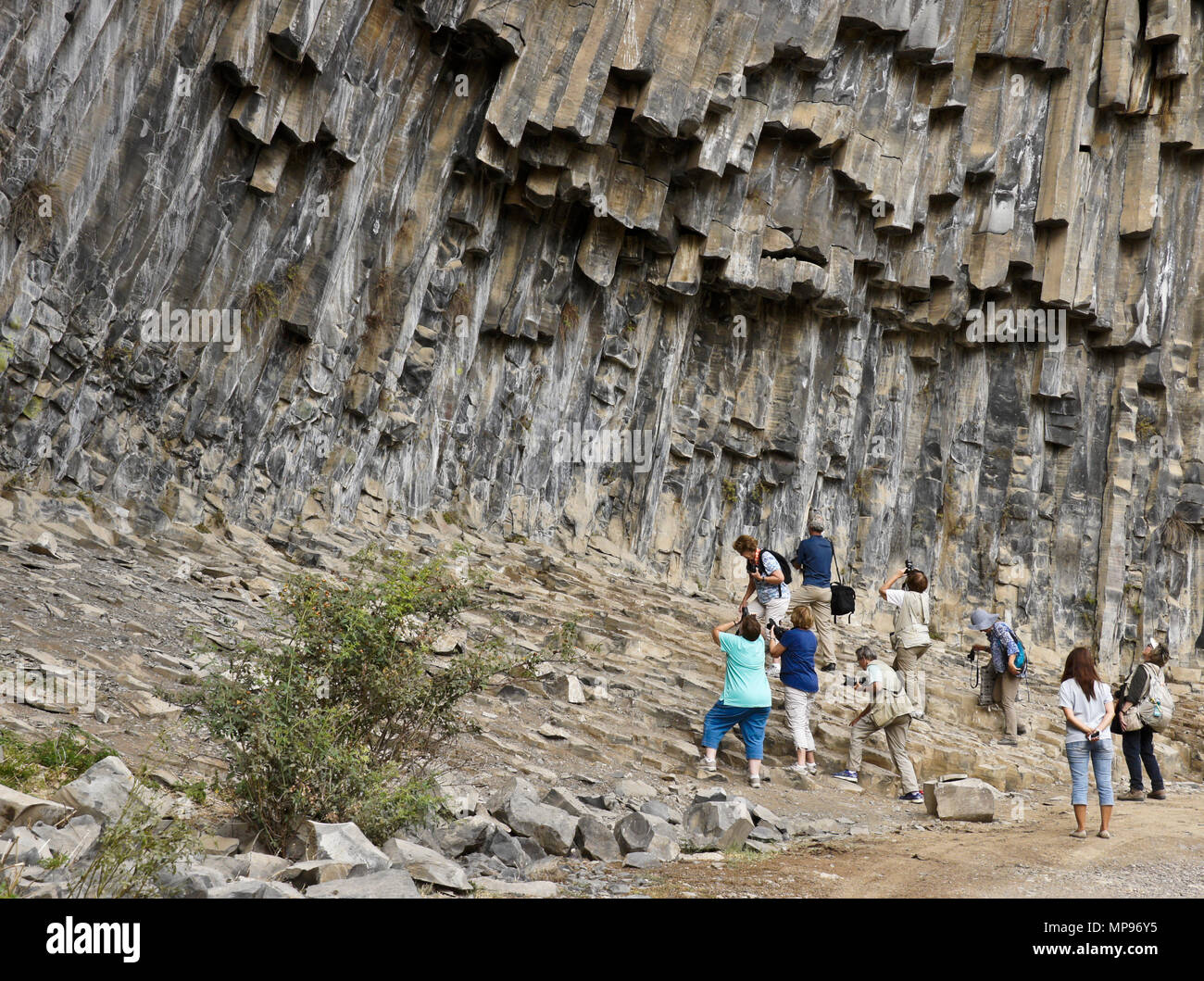 Garni, Armenia: In Garni Gorge, tourists photograph a geological formation of octagonal basalt columns called the Symphony of Stones. - Stock Image