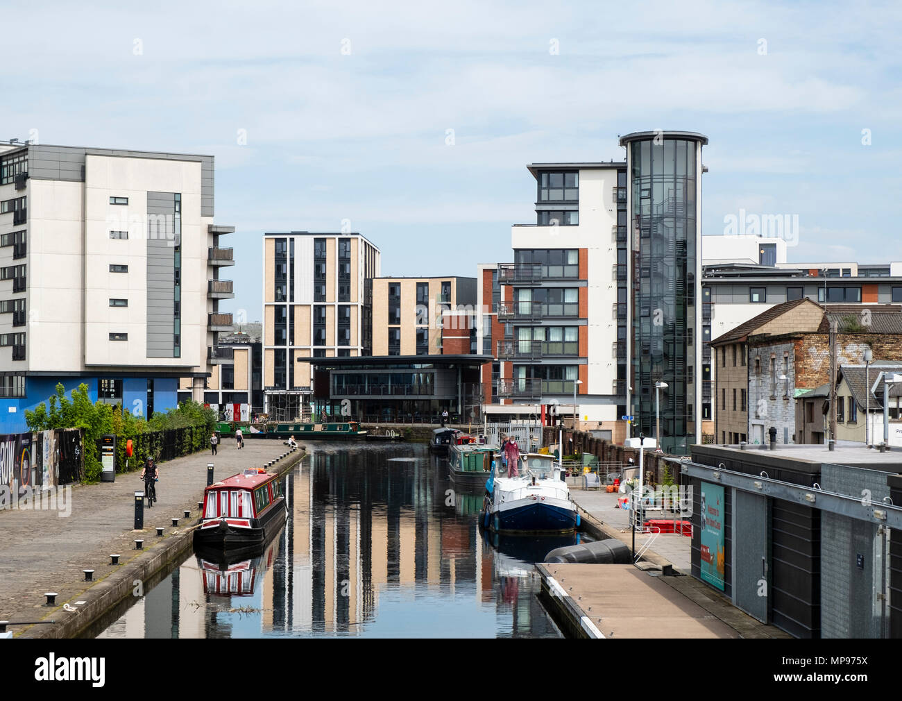 View of Union Canal at Lochrin Basin with modern new apartment buildings  at Fountainbridge in Edinburgh, Scotland, United Kingdom, UK - Stock Image
