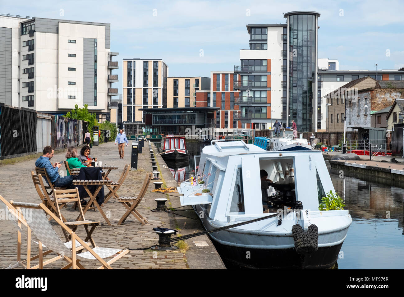 View of Union Canal at Lochrin Basin with cafe boat moored at Fountainbridge in Edinburgh, Scotland, United Kingdom, UK - Stock Image