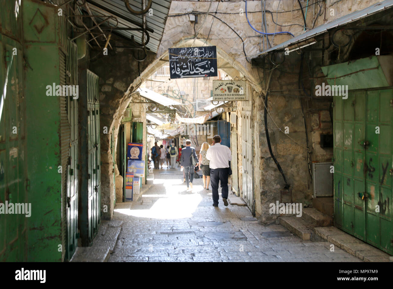 Jerusalem, Israel - May 16, 2018: View into an alley of the bazaar in the Old City of Jerusalem, Israel. - Stock Image