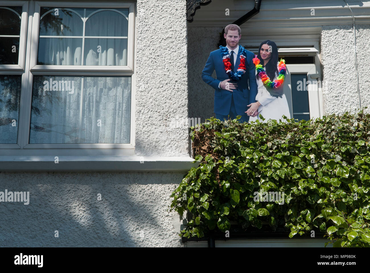 Royal Wedding Prince Harry Meghan Markle, Duke Duchess of Sussex cut out cardboard figures of couple private home balcony Windsor. 19th may 2018 HOMER SYKES Stock Photo