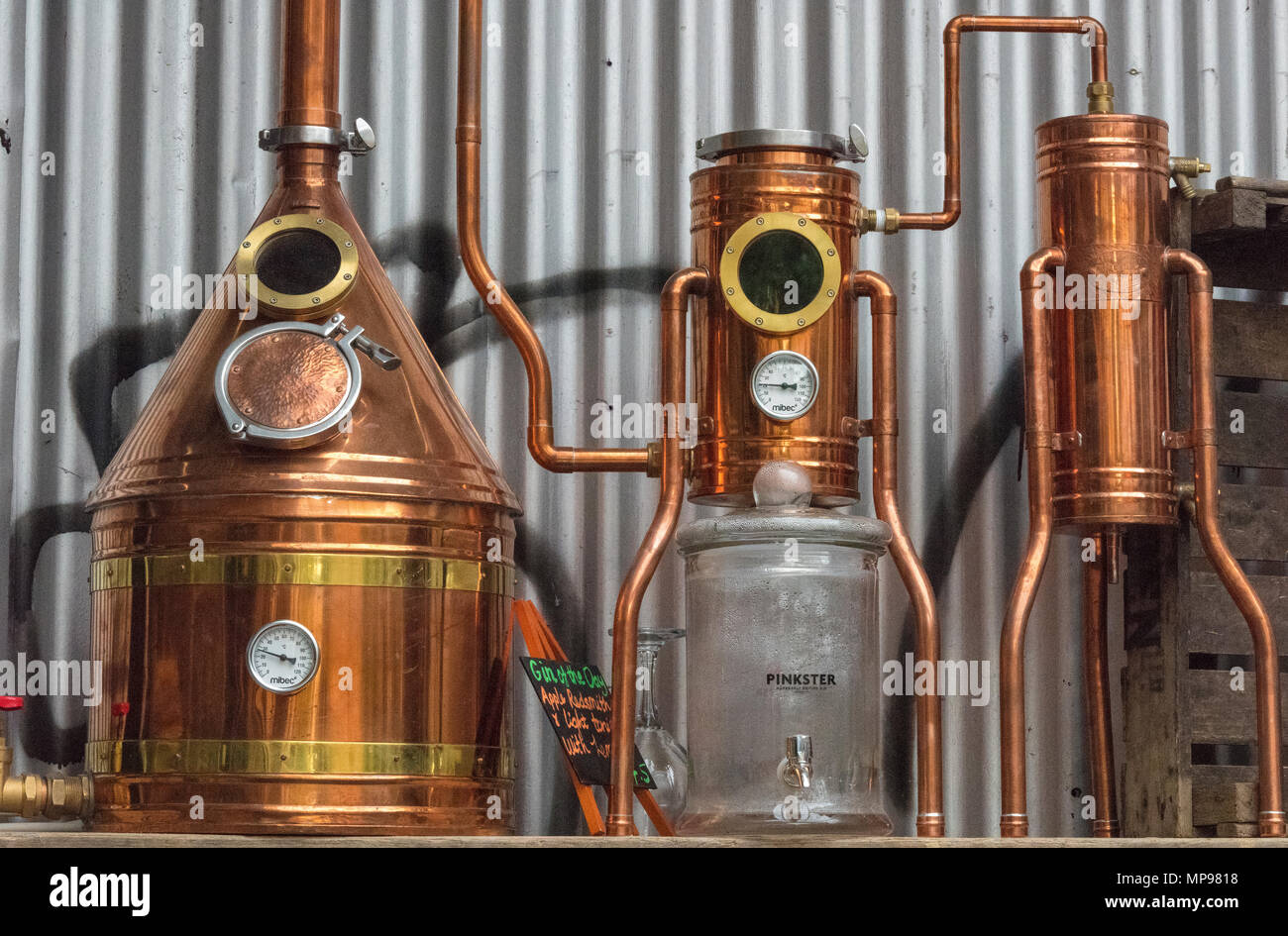 A still or distillery equipment made from copper at a gin manufacturer in central london. Micro breweries and distilling gin with basic kit and gear. - Stock Image