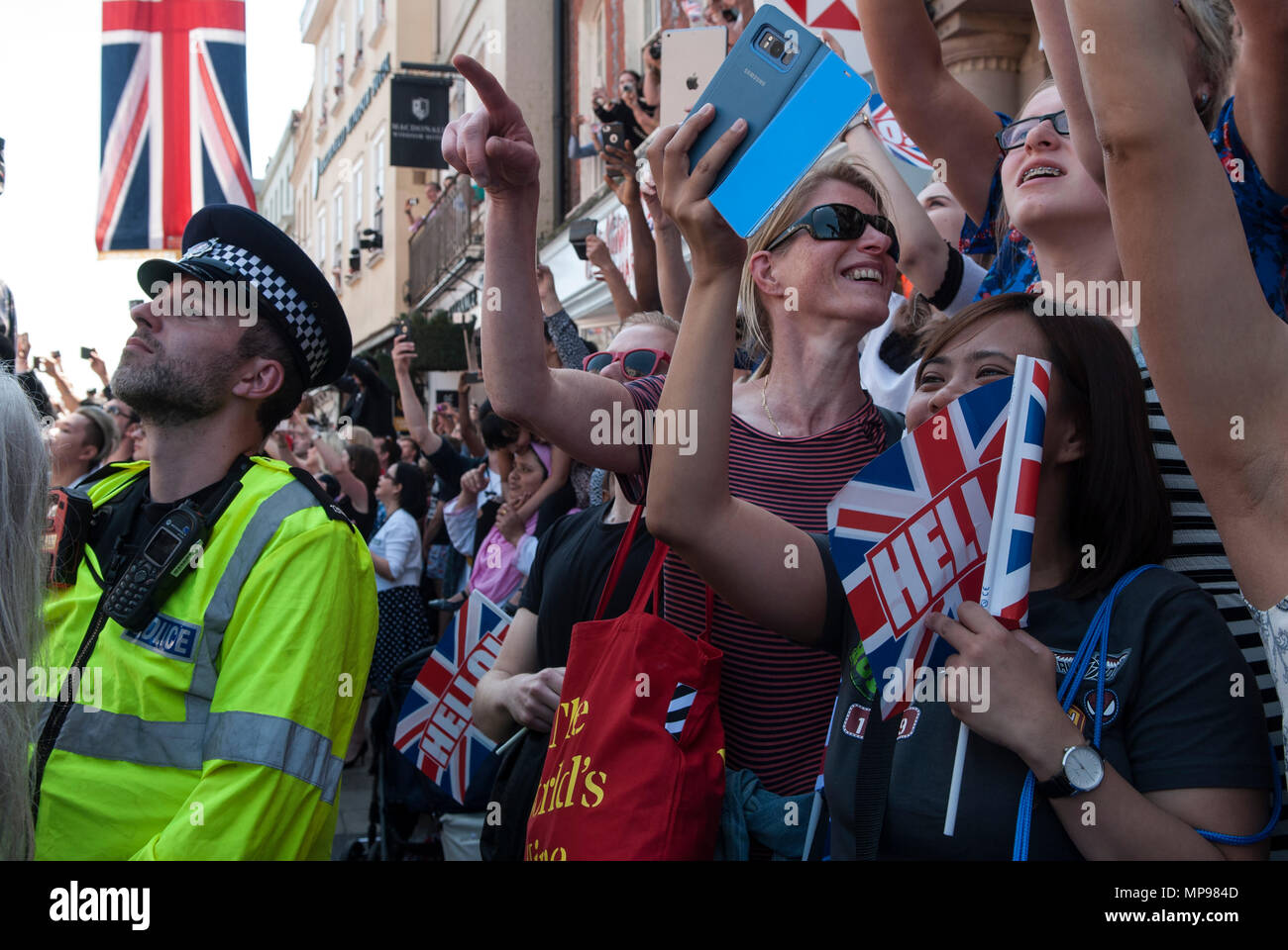 People in crowd with mobile devises phones iphones i phone tourists watching Royal Wedding Prince Harry Meghan Markle  procession  Windsor Uk 2018 HOMER SYKES Stock Photo
