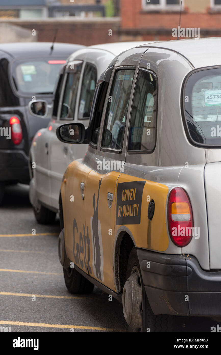A queue of london black cabins or taxis outside of london waterloo railway station waiting for. Fares or passengers. Public transport in the city. Stock Photo