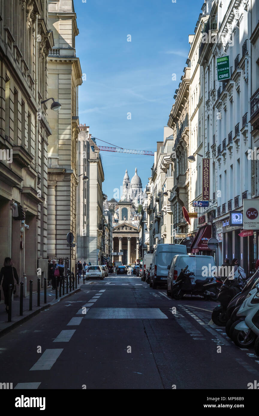 Paris, France - April 17, 2018: Rue Laffitte on a weekday with the Sacre Coeur in the background Stock Photo