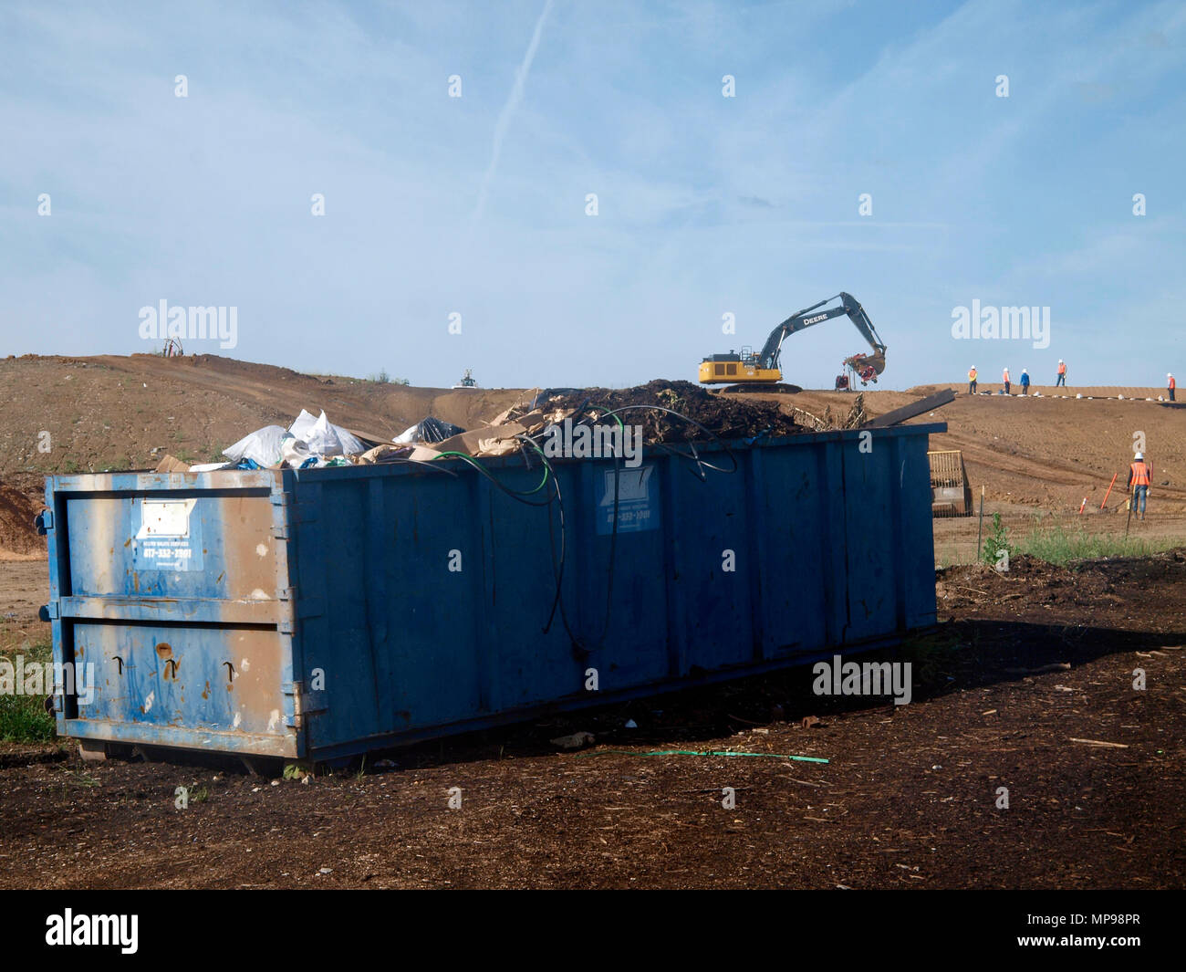 In the rapidly growing Dallas and Fort Worth Texas area, their is also a growing problem to handle all the garbage. Landfills are climbing higher and many fear they pollute the air they breath and the water they drink. Just a sign of disposable consumption. - Stock Image