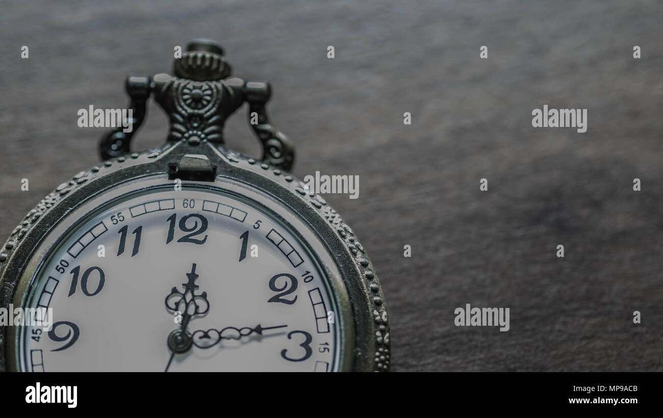 old vintage pocket watch showing time on wooden background Stock Photo