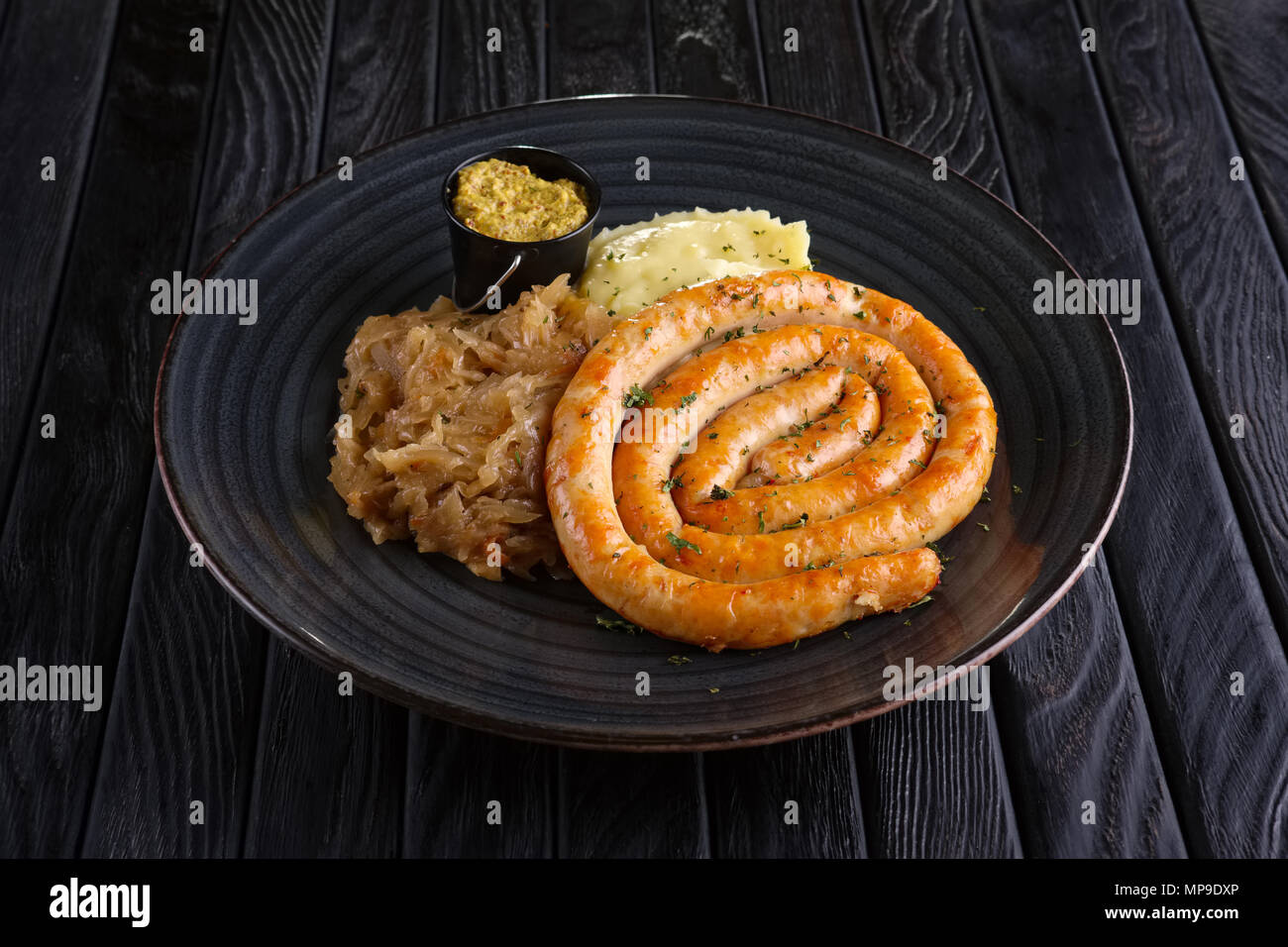 Homemade sausage with braised cabbage and mashed potato Stock Photo