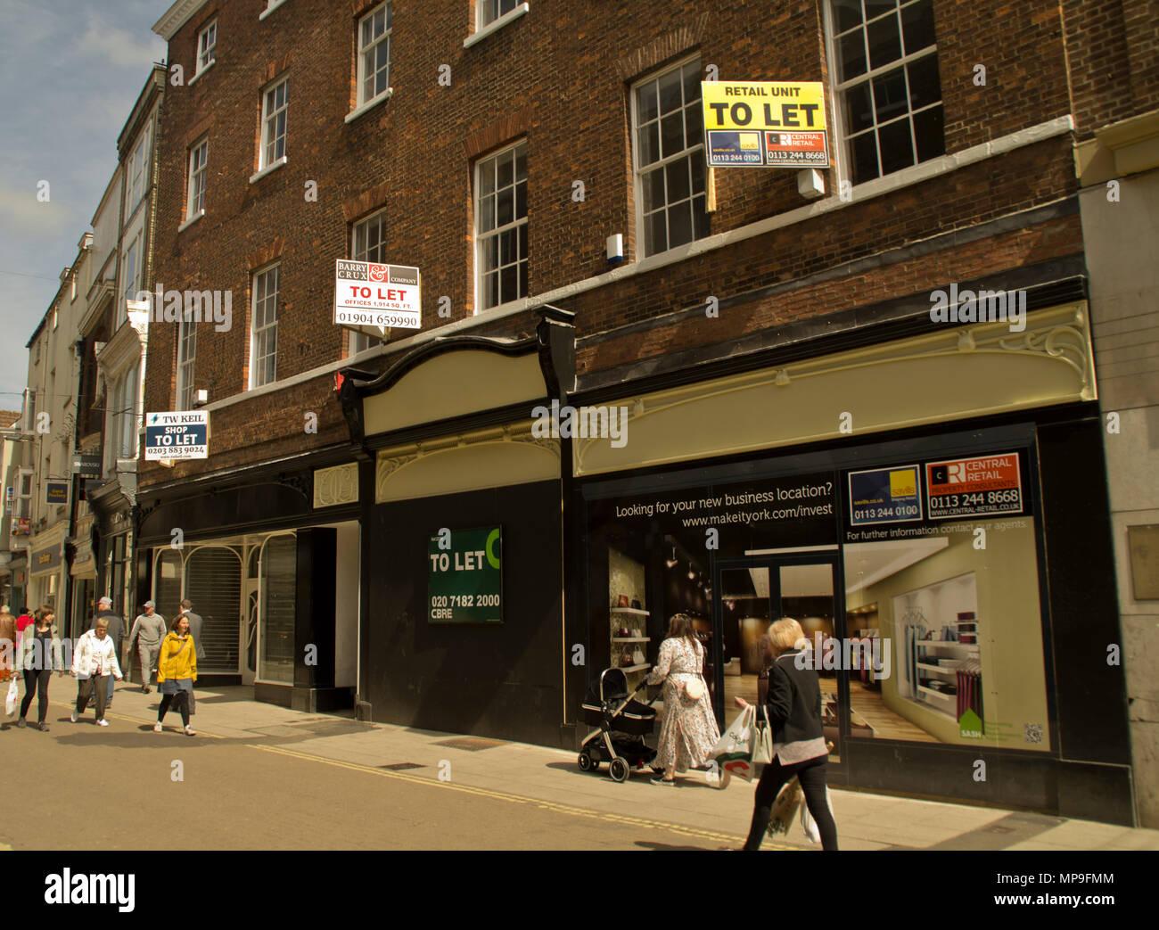 Empty stores Coney Street York - Stock Image