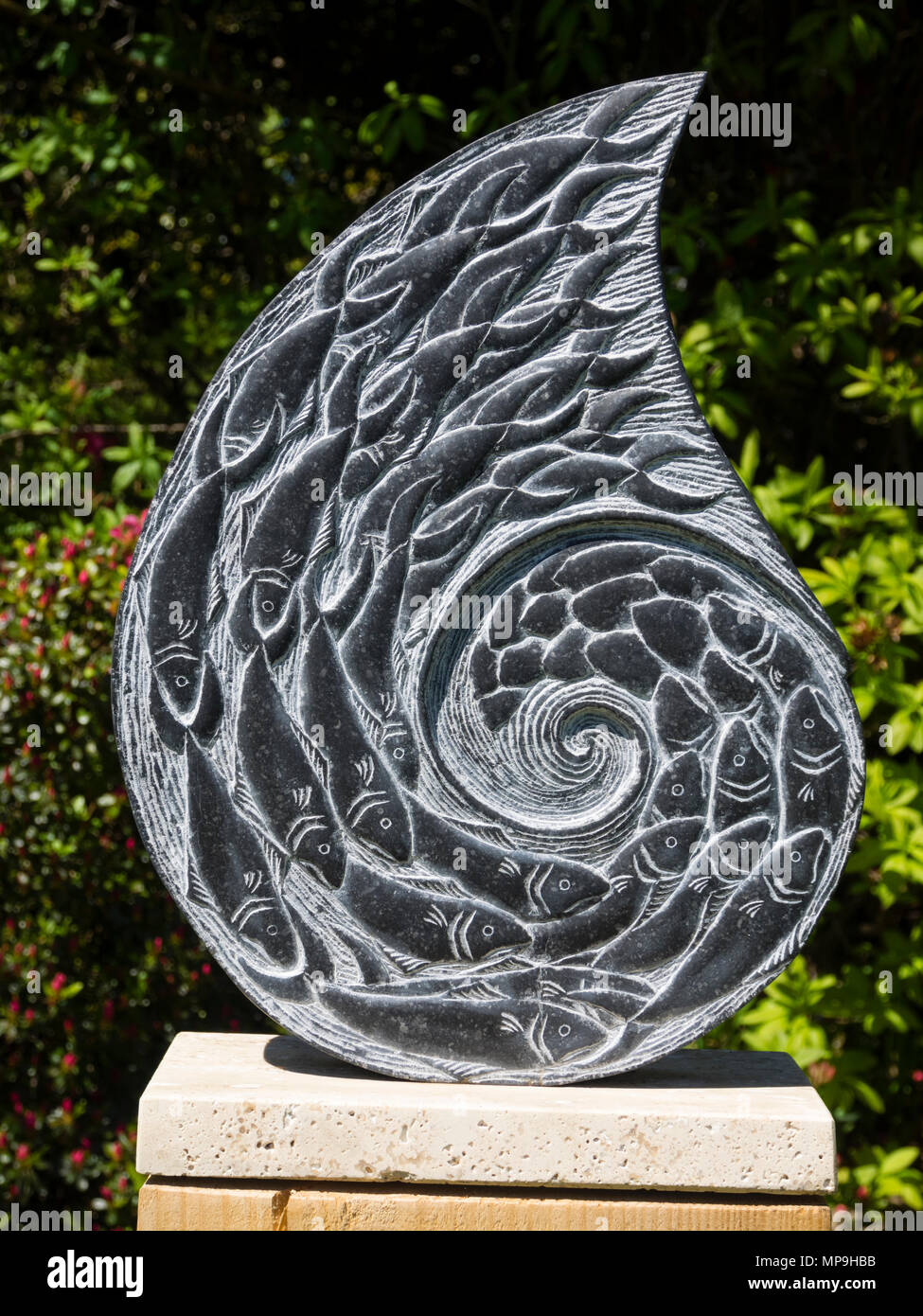 Zoe Singleton's 'The Turning Tide', a sculpture carved form Kilkenny Limestone exhibited at delamore Arts, Devon, UK - Stock Image