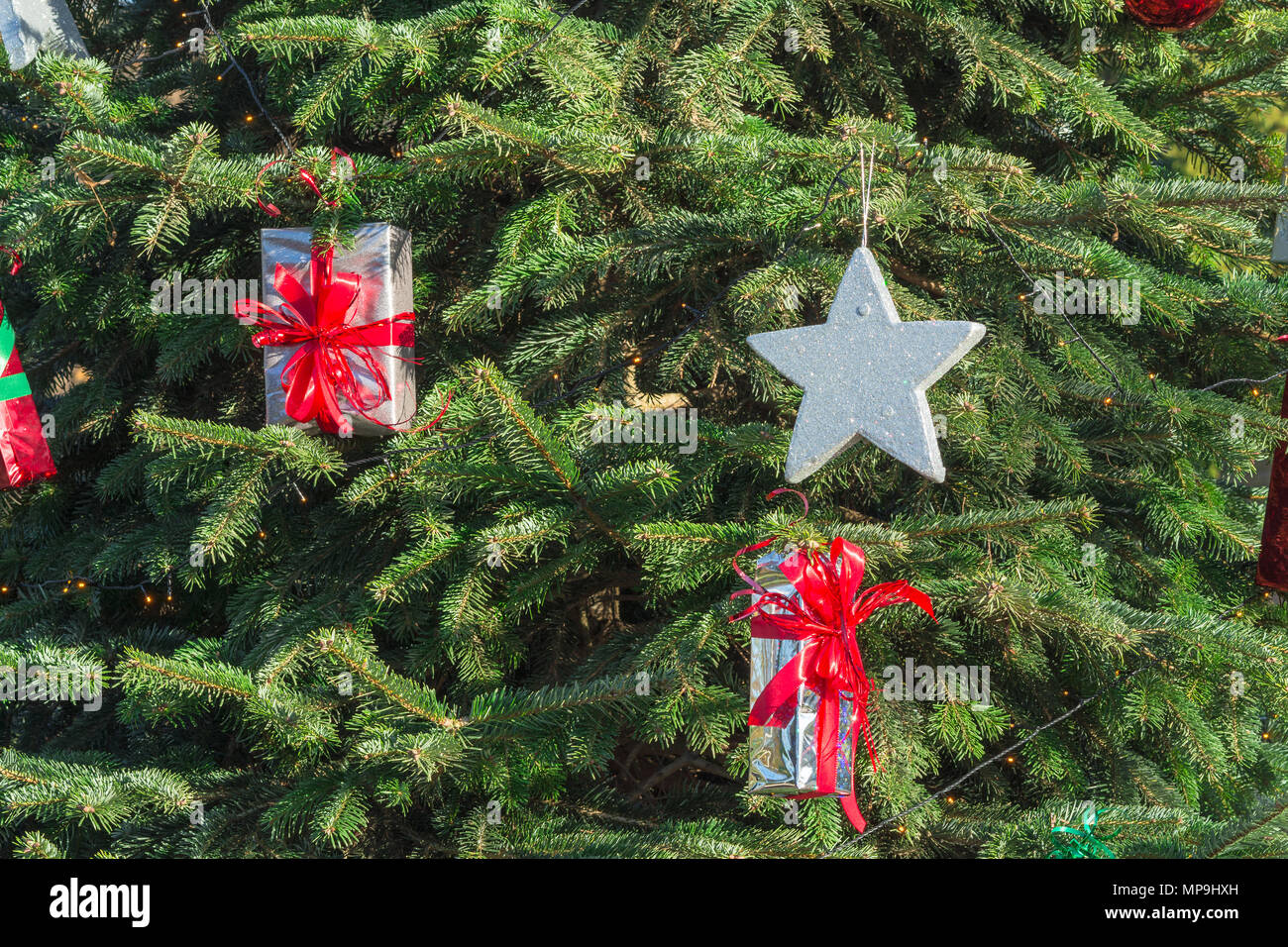 Beautiful christmas tree with gift boxes and shopping bags stock