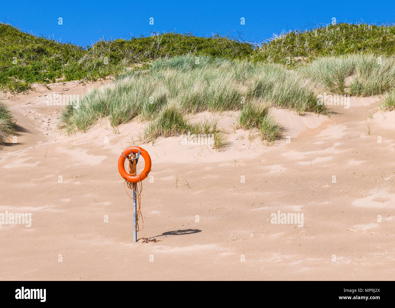 Lifebelt on Broad Haven South Beach in South Pembrokeshire, Wales - Stock Image