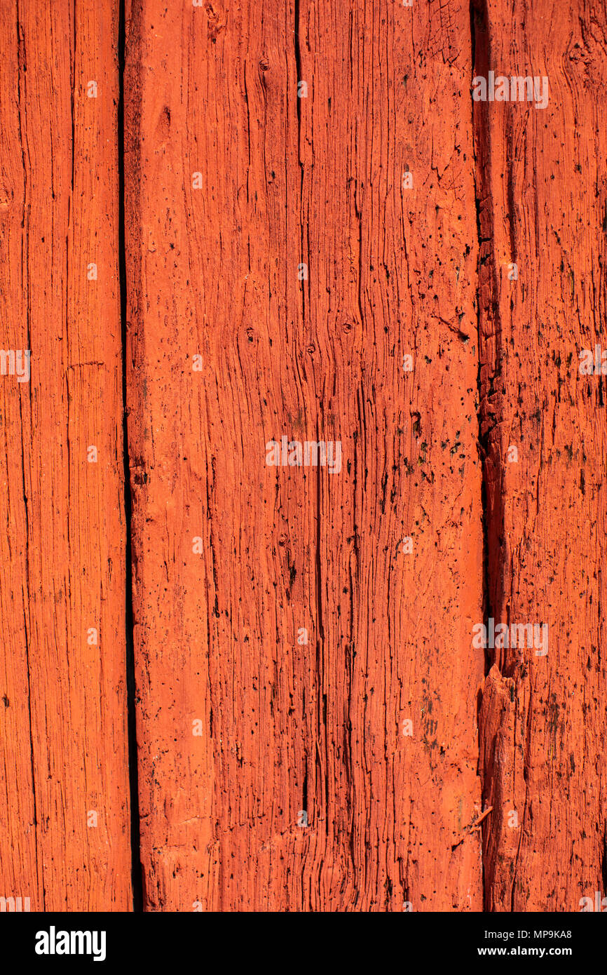 The classic red colour on a wooden wall on a red house in Sweden Dalarna - Stock Image