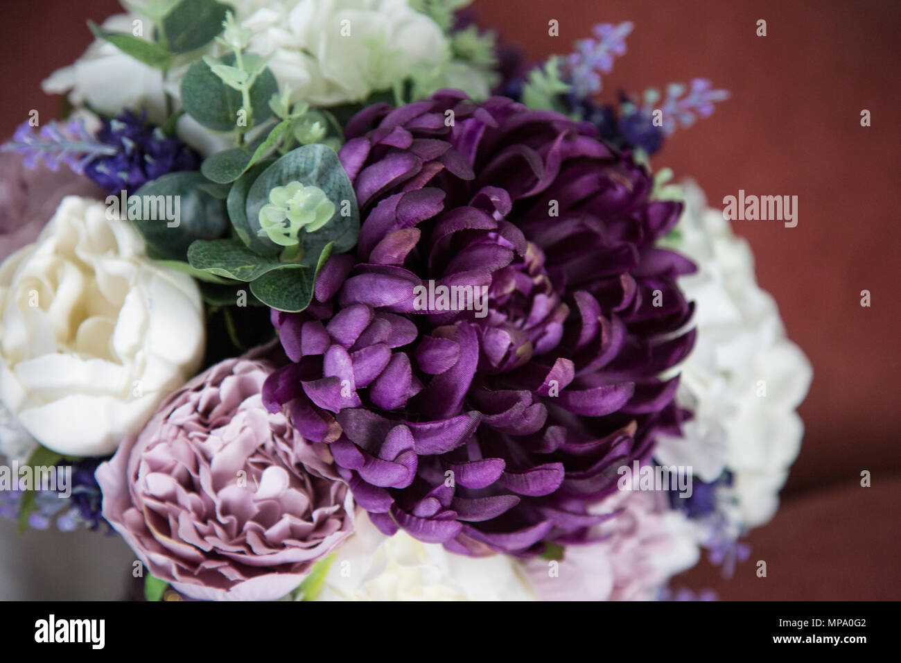 Close Up Of A Brides Bouquet On Her Wedding Day With Purple Flowers
