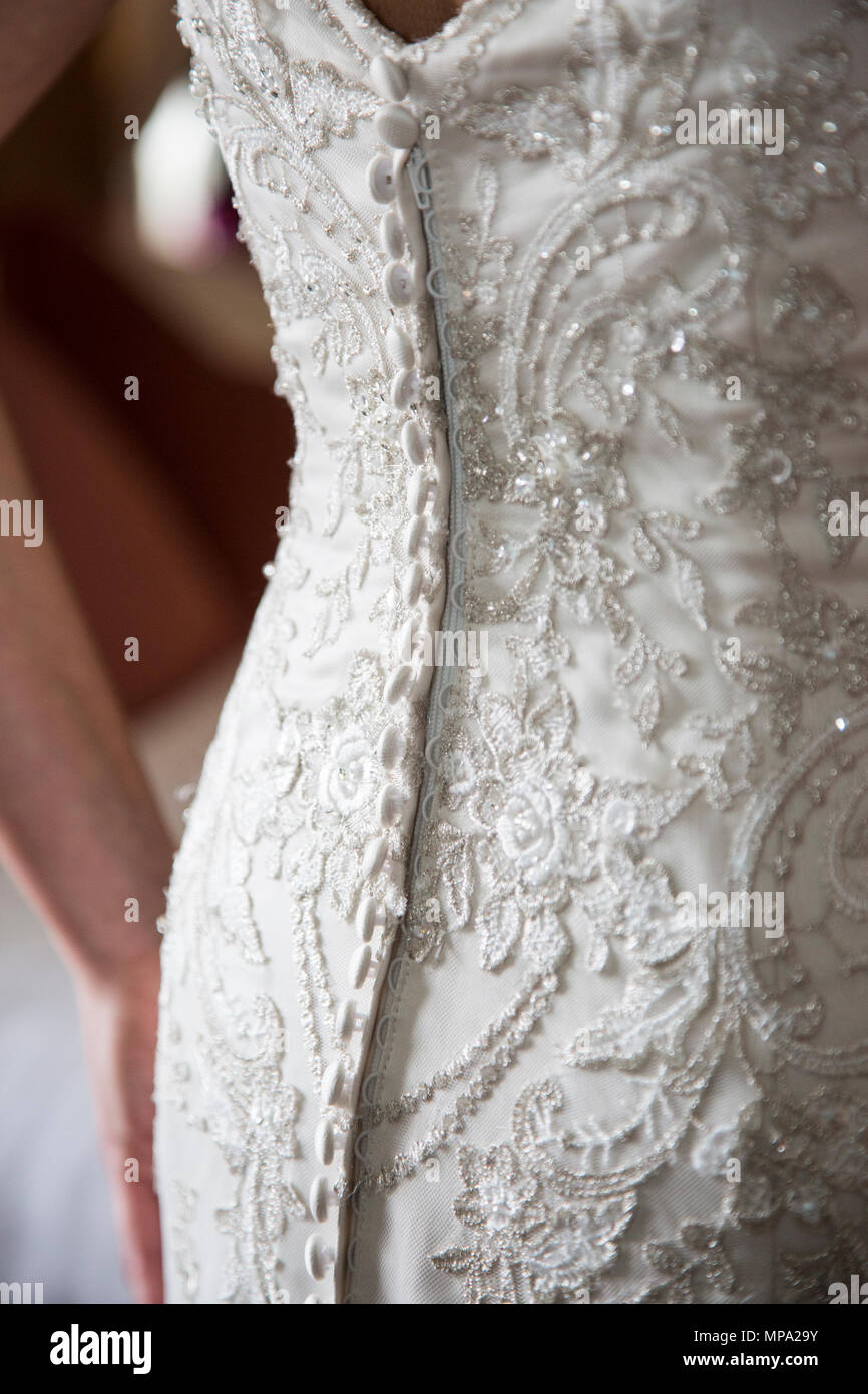 Wedding Dress Detail Of Buttons And Lace On The Back Of A Wedding
