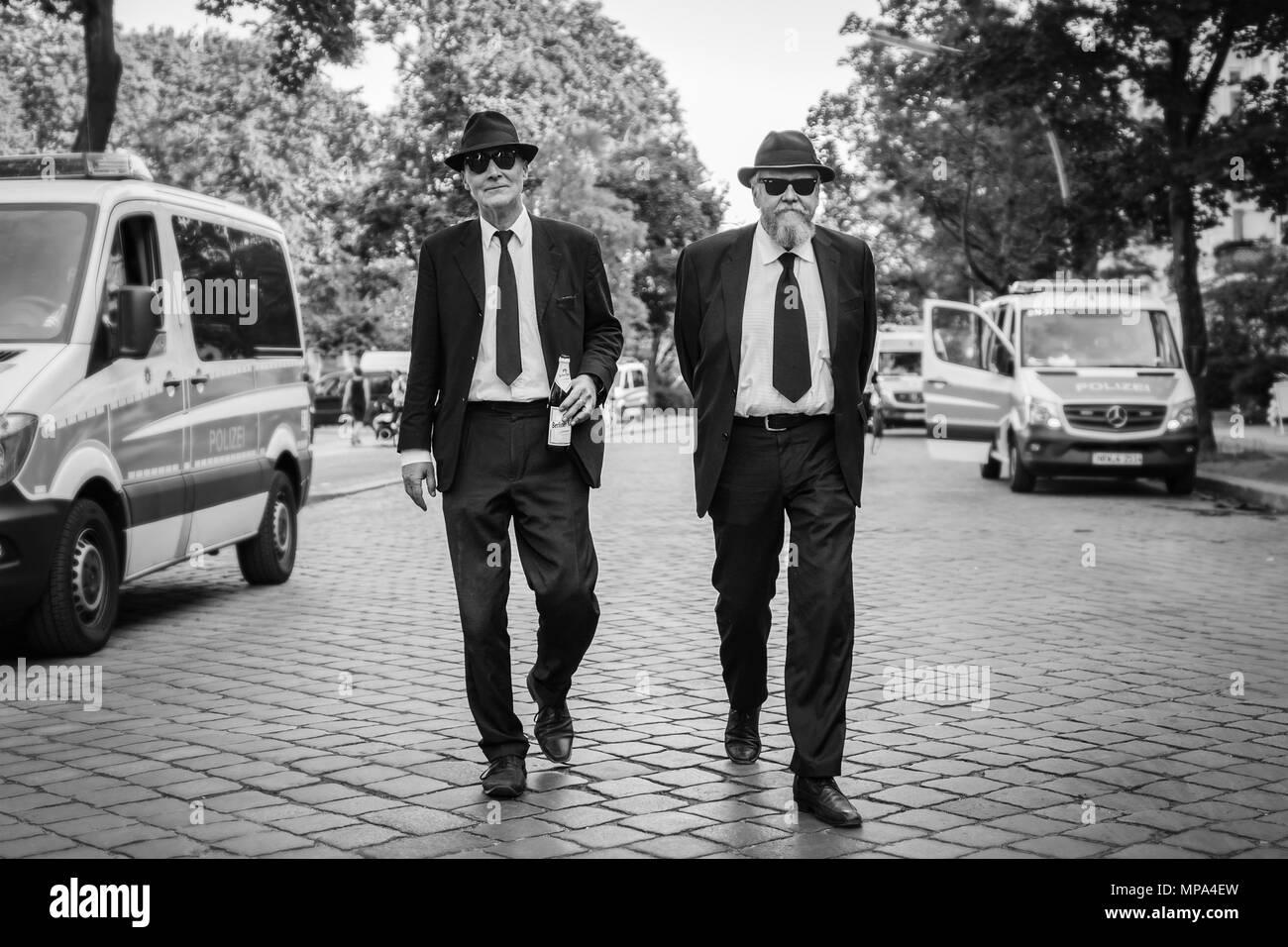 Two gentlemen dressed as the Blues Brothers attend Karneval der Kulturen 2018. - Stock Image