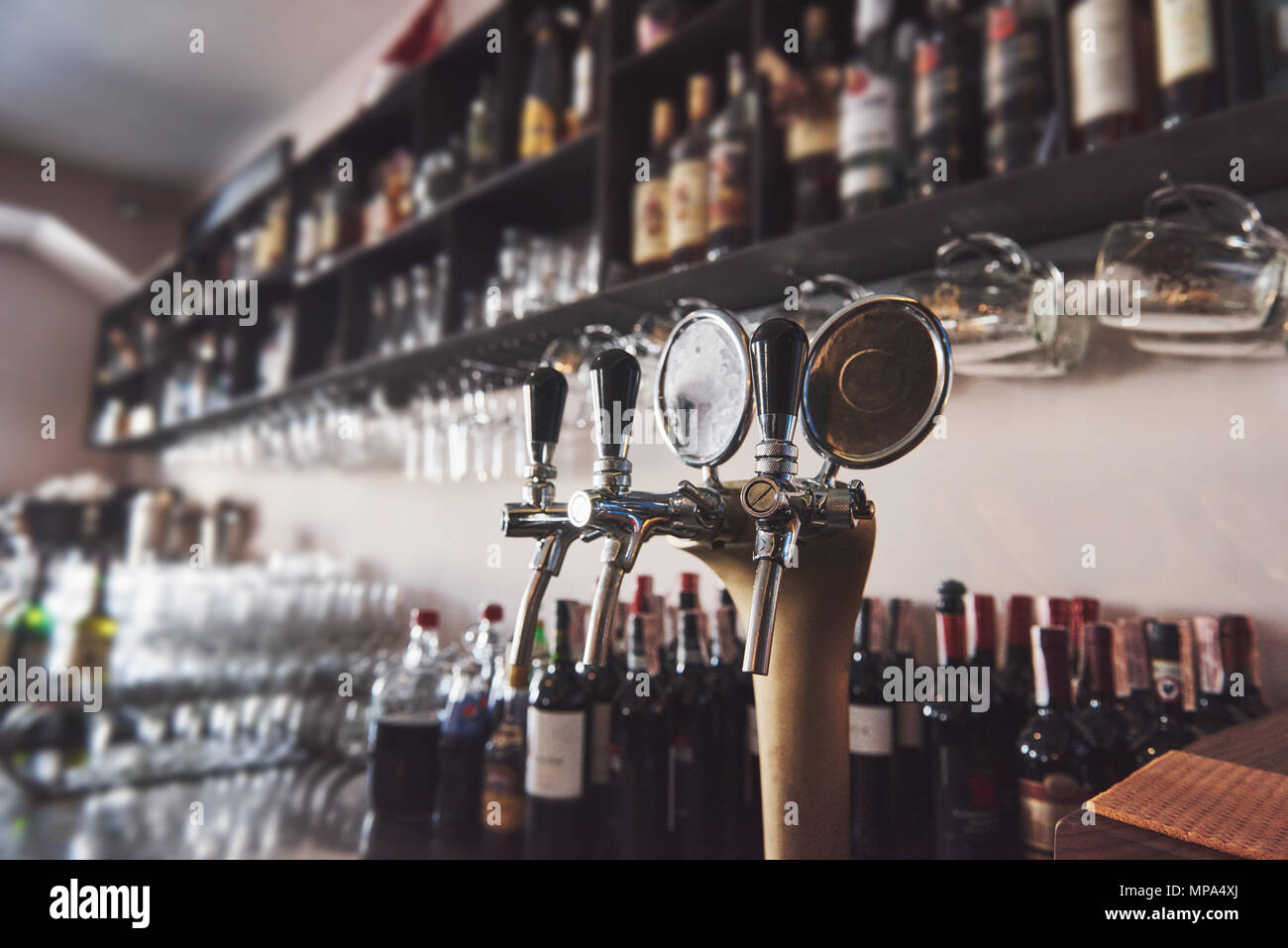 ready to pint of beer on a bar in a traditional style wooden pub Stock Photo