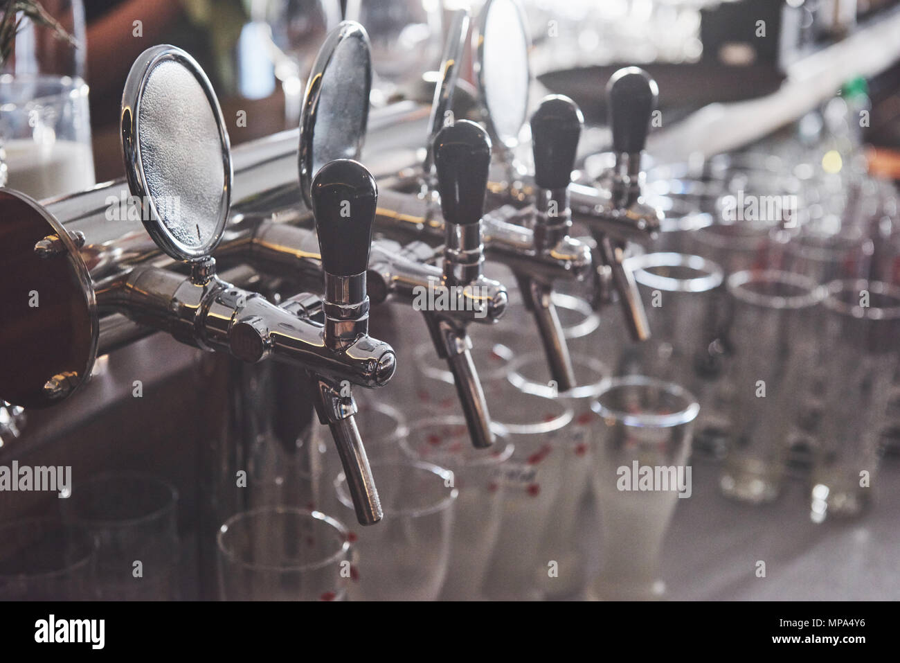 ready to pint of beer on a bar in a traditional style wooden pub - Stock Image