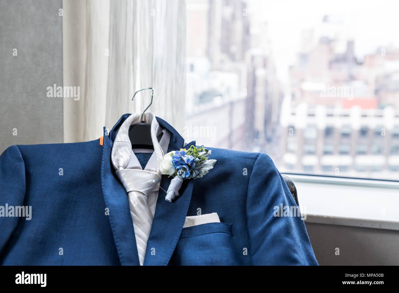 231bc17d96bdb Men's suit and tie groom closeup with flower boutonniere, pin wedding  preparation, pocket handkerchief