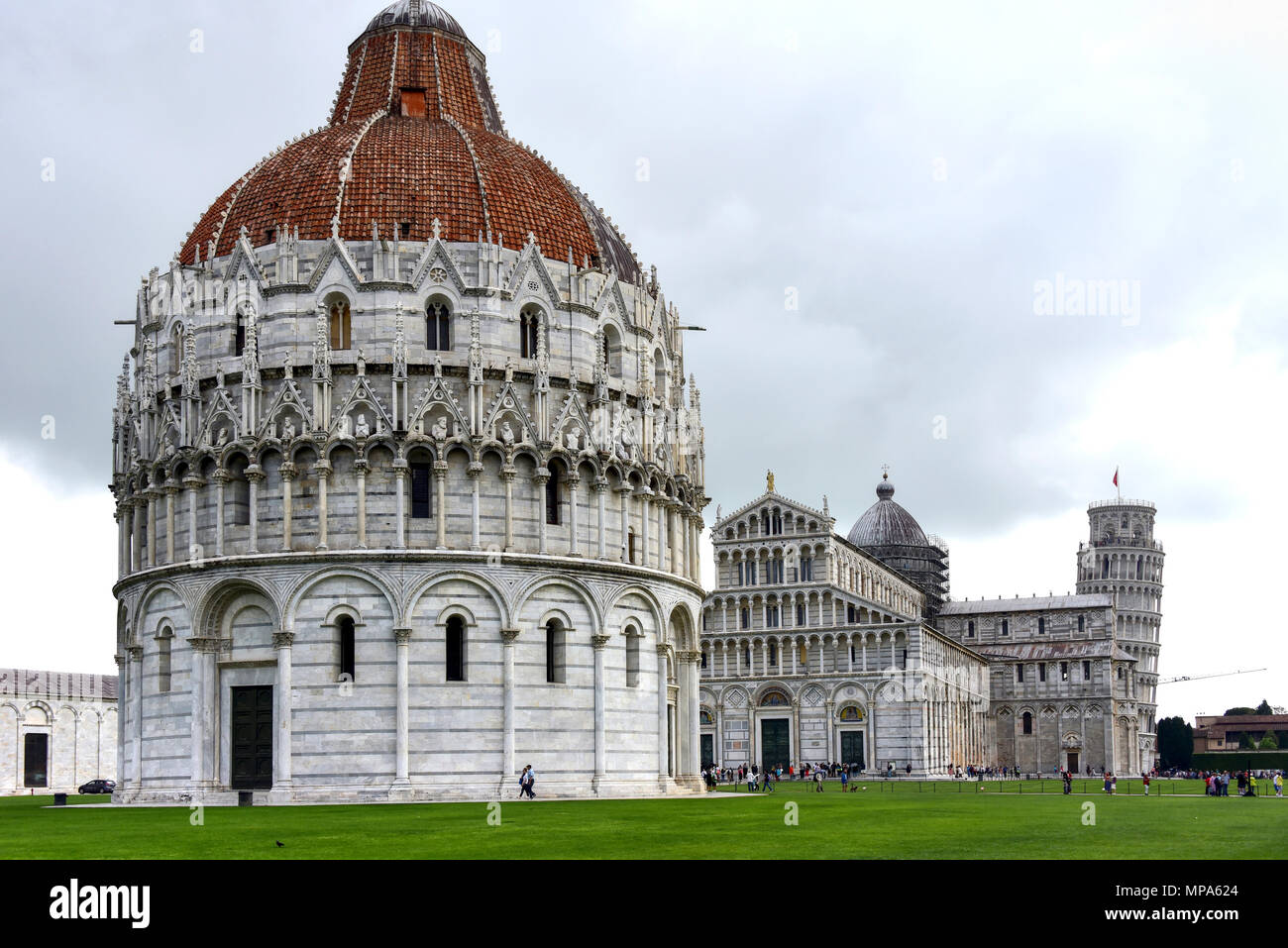 The Pisa Baptistery, the Pisa Cathedral and the Tower of Pisa located in the Piazza dei Miracoli (Square of Miracles) in Pisa, Italy. - Stock Image