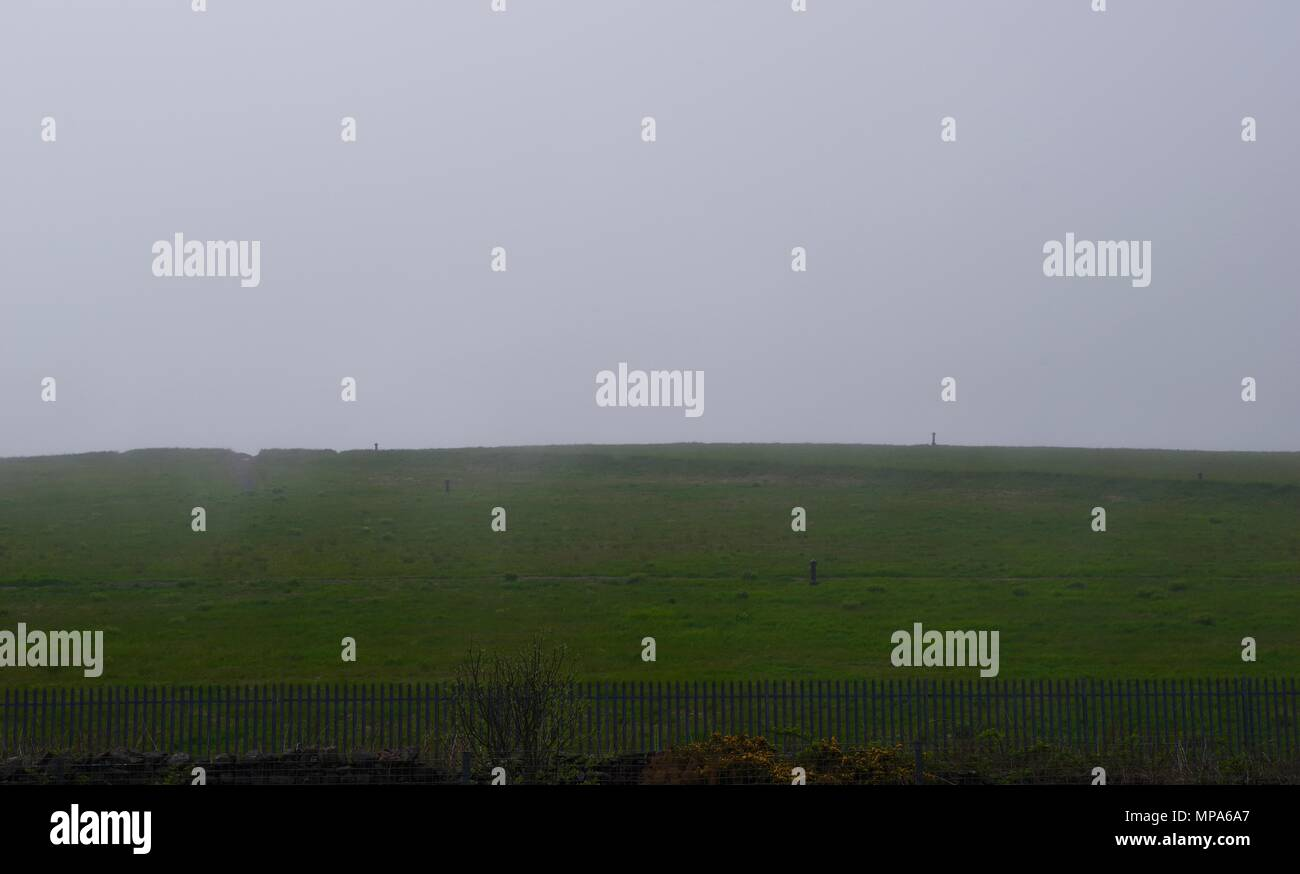 Covered Landfill Site, Grass Hill under Sea Fog. Hair. Aberdeen, Scotland, UK. May, 2018. - Stock Image