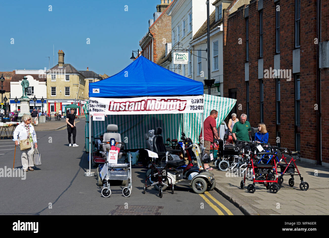 Market stall selling mobility scooters, St Ives, Cambridgeshire, England UK - Stock Image
