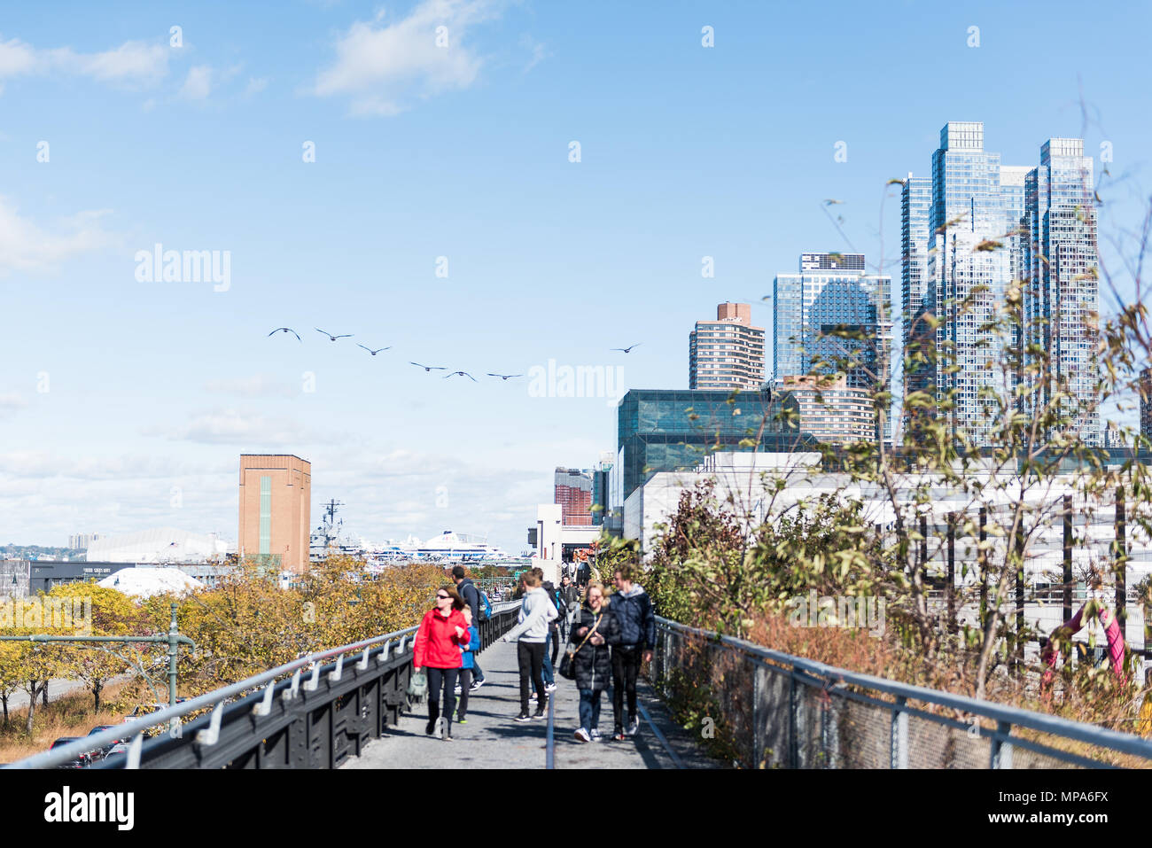New York City, USA - October 30, 2017: Highline, high line, urban in NYC with people tourists walking in Chelsea West Side by Hudson Yards in autumn f Stock Photo