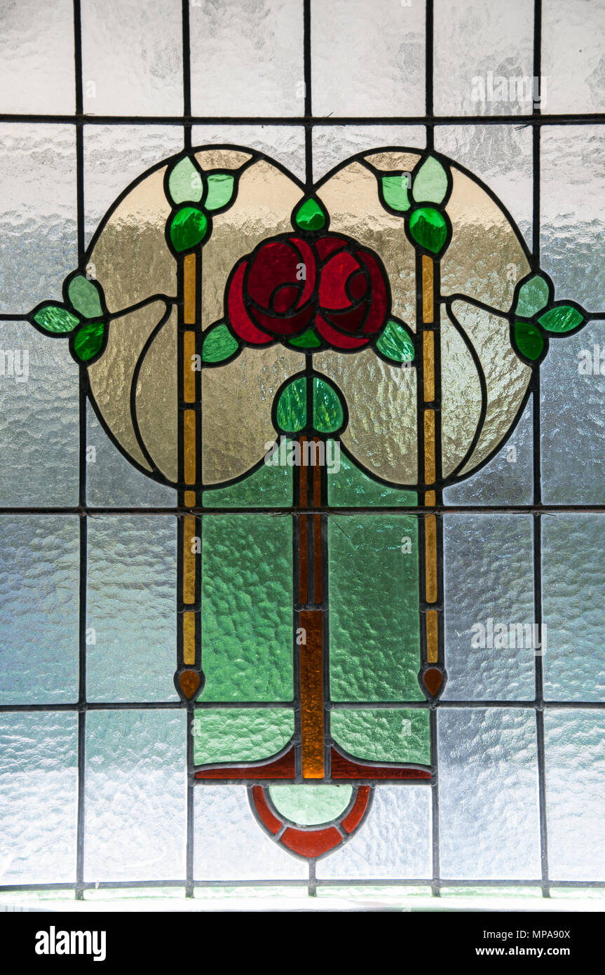 Leadlight glass motifs in a 1913 Art Nouveau Queenslander house, Brisbane, Australia - Stock Image