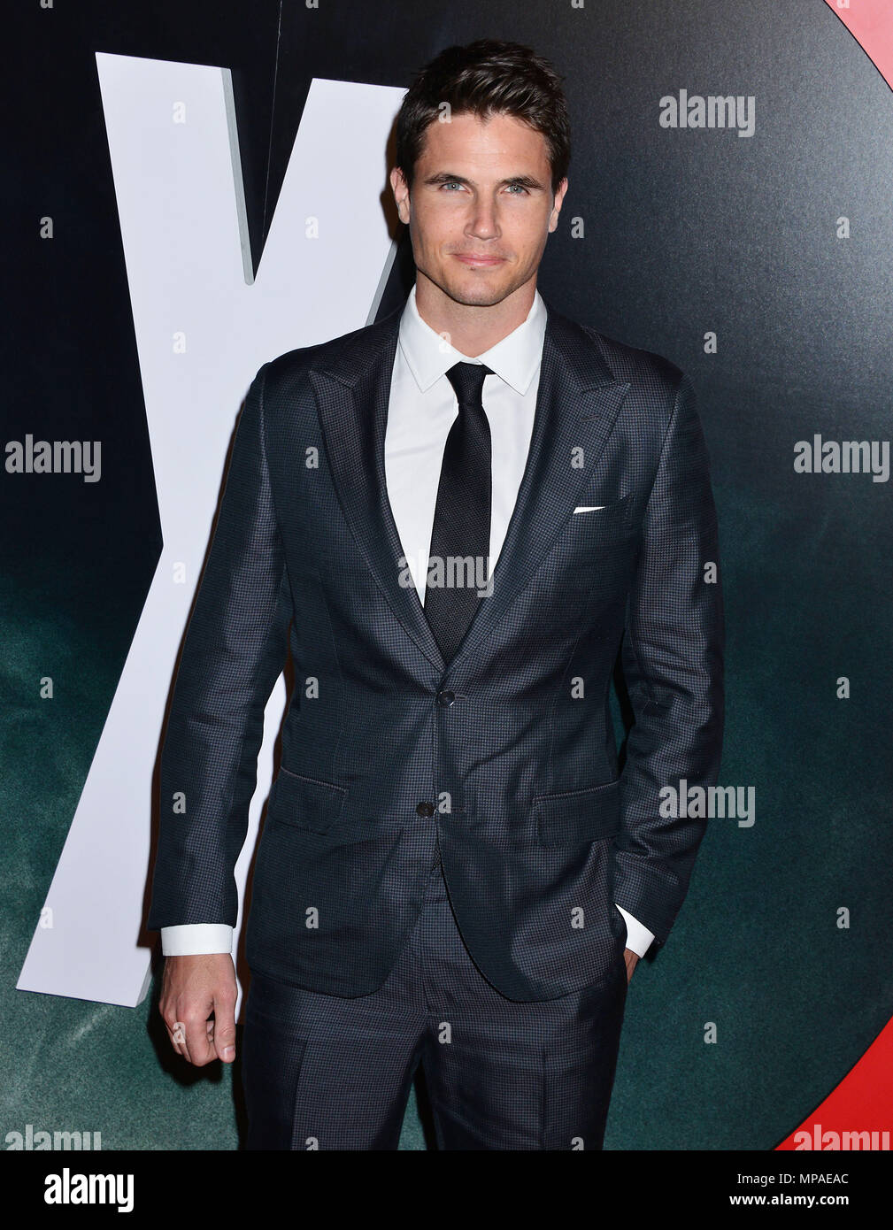 Robbie Amell 039  at The X-Files Premiere at California Science Center in Los Angeles, CA  January 12, 2016.Robbie Amell 039 ------------- Red Carpet Event, Vertical, USA, Film Industry, Celebrities,  Photography, Bestof, Arts Culture and Entertainment, Topix Celebrities fashion /  Vertical, Best of, Event in Hollywood Life - California,  Red Carpet and backstage, USA, Film Industry, Celebrities,  movie celebrities, TV celebrities, Music celebrities, Photography, Bestof, Arts Culture and Entertainment,  Topix, Three Quarters, vertical, one person,, from the year , 2016, inquiry tsuni@Gamma-USA - Stock Image