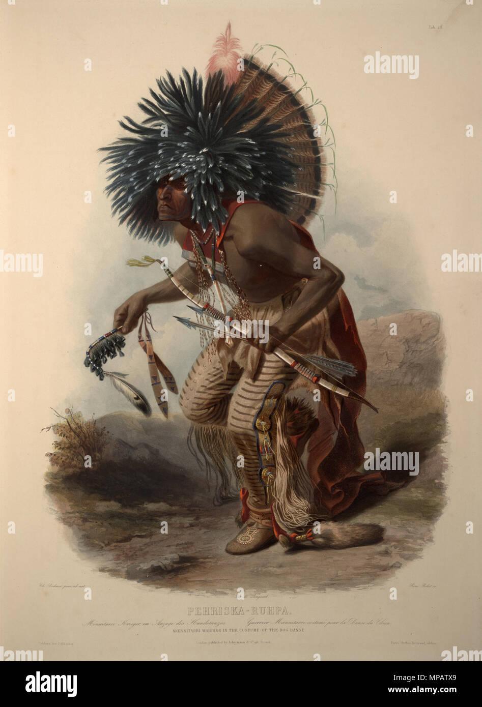 Moenitarri warrior in the costume of the dog danse   between
