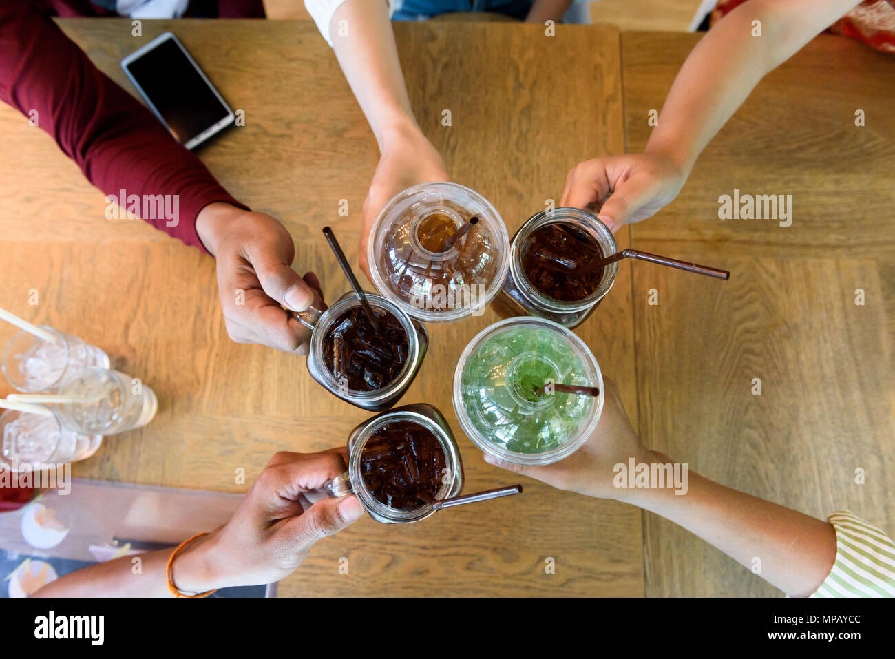 People in the party pity the glass in the conference room. - Stock Image