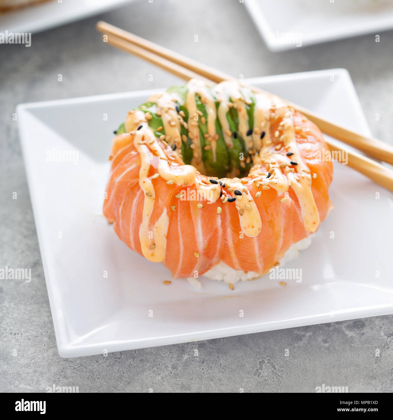 Sushi donuts with tuna and salmon - Stock Image