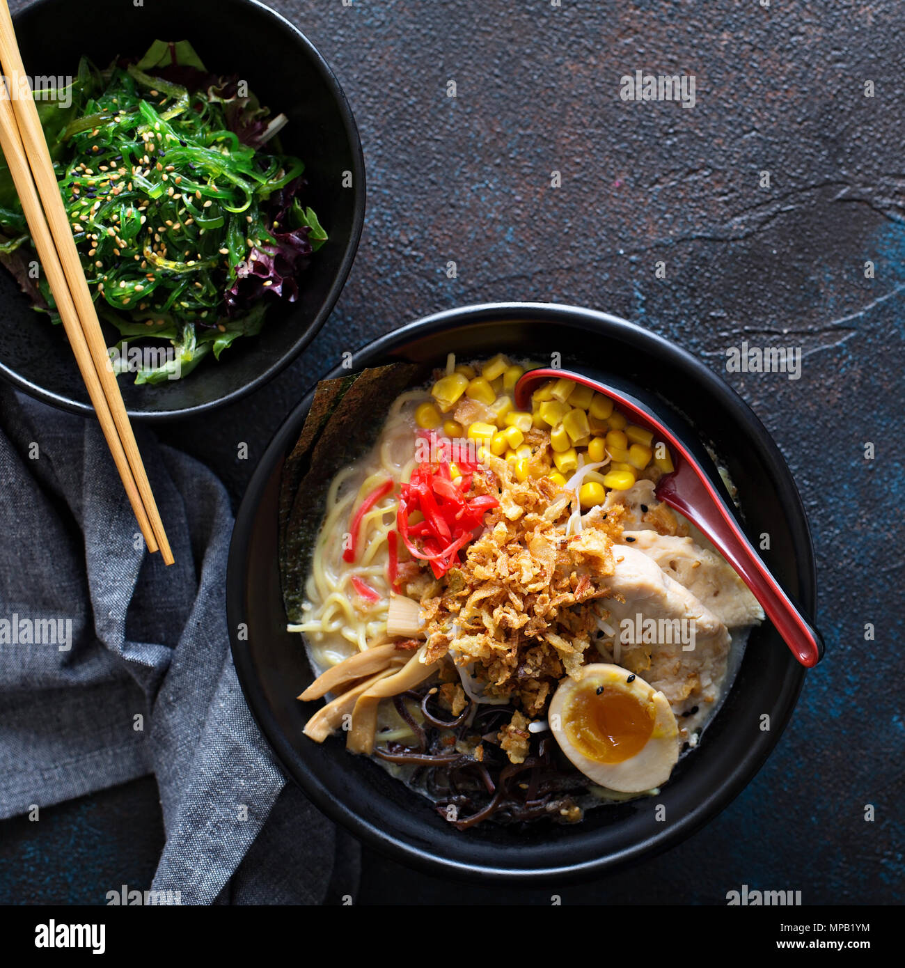 Spicy ramen bowls with noodles, pork and chicken - Stock Image