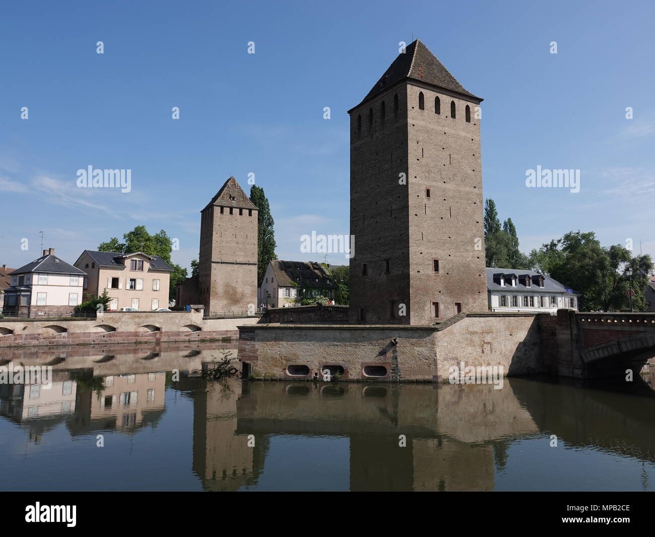 Brick towers along the Ill River, remaining parts of the old fortifications, Strasbourg, France - Stock Image
