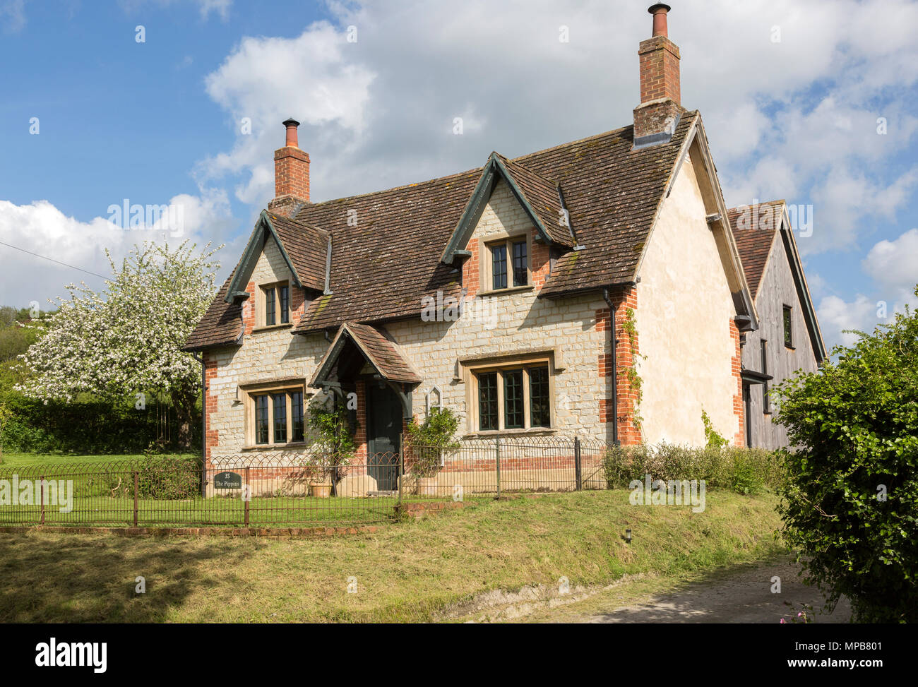 Attractive detached house built from chalk stone in village of Compton Bassett, Wiltshire, England, UK - Stock Image