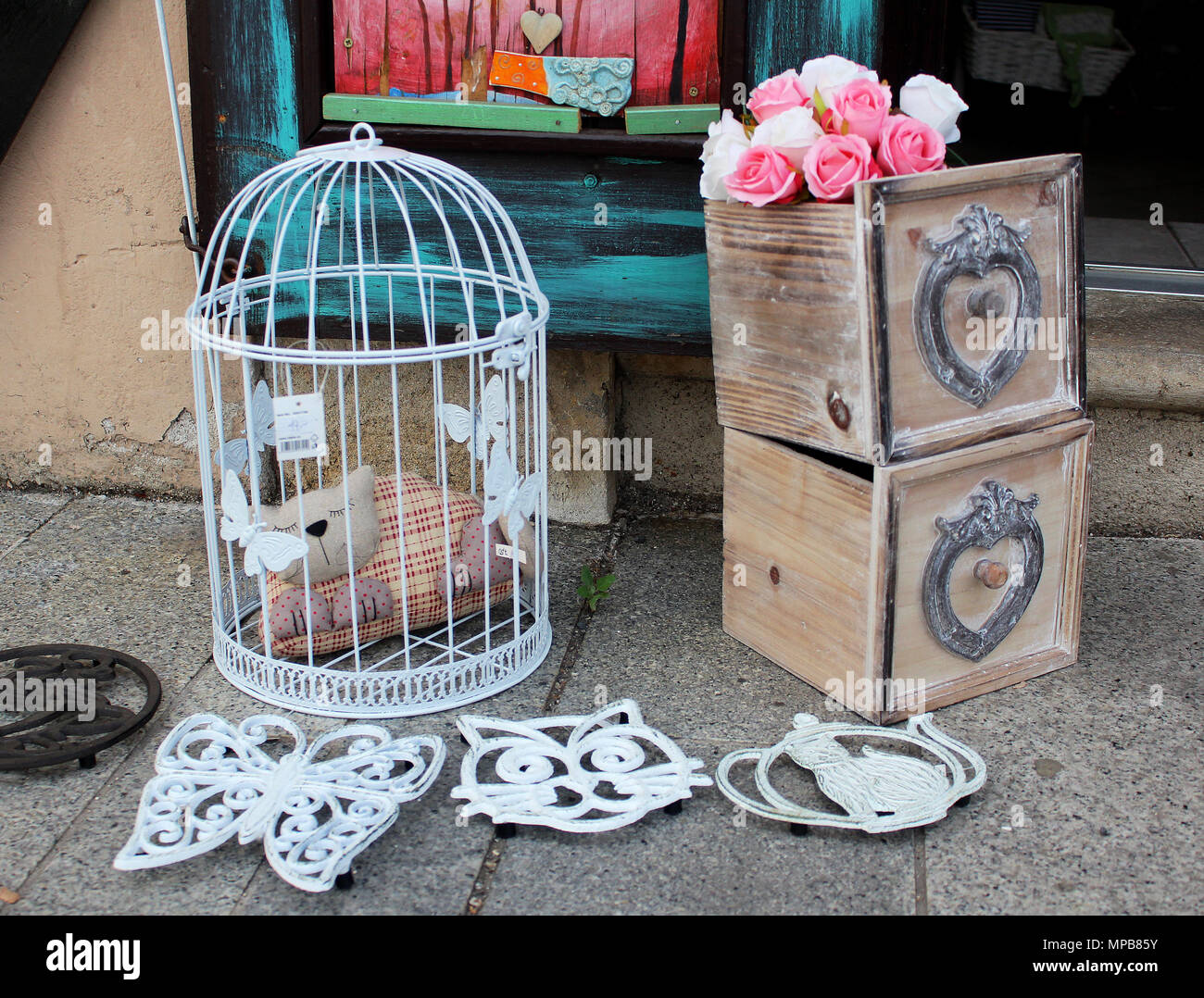 Still life - vintage decorative bird cage with statue of a
