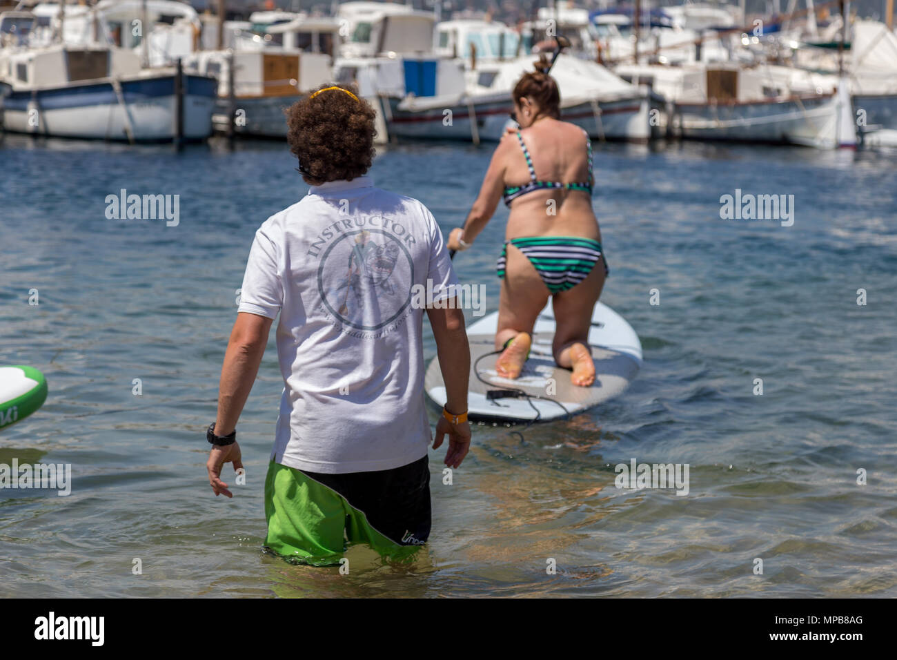Paddle trainer on the beach in Palamos, Costa Brava. 20. 05. 2018 Spain - Stock Image