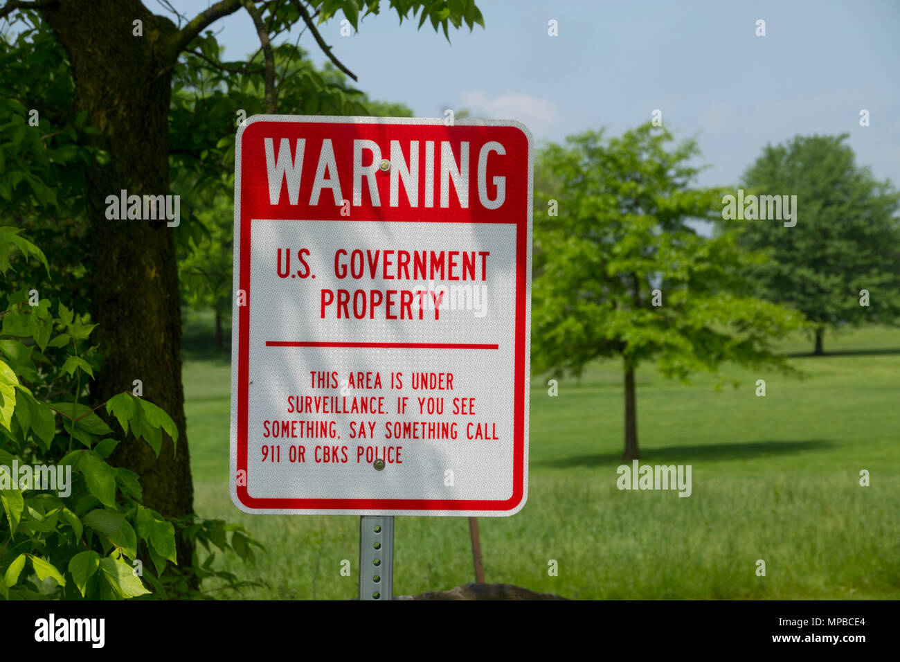 Warning Sign by the United States of America Federal government that area is under surveillance  of land property - Stock Image