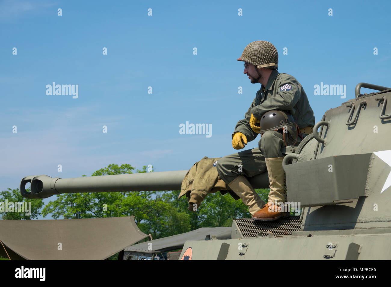 The U.S. Army Heritage and Education Center a WWII re-enactor on a M18 Hellcat tank destroyer in Carlisle Pennsylvania - Stock Image