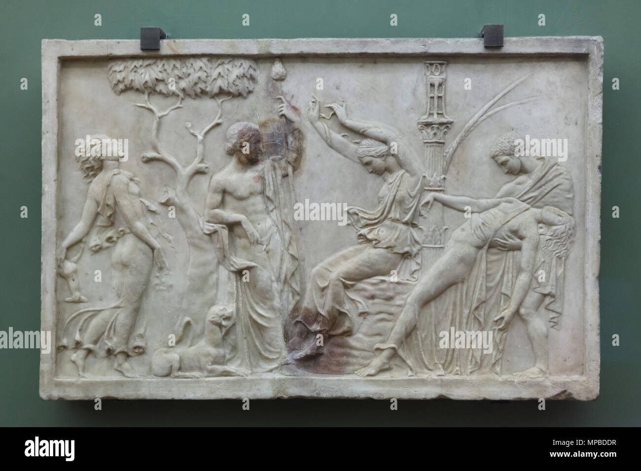 Dionysian scene depicted in the Roman marble relief from the first half of the 1st century AD on display in the Uffizi Gallery (Galleria degli Uffizi) in Florence, Tuscany, Italy. Dionysus is depicted surrounded by drunken Maenads. Stock Photo