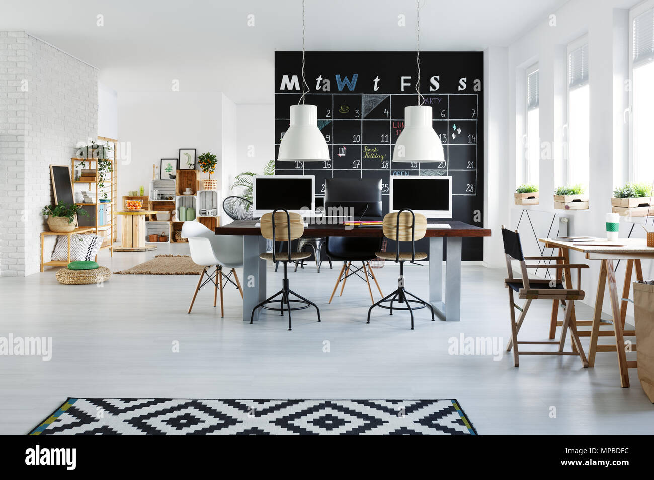 White Office Interior With Desk Computers Chair And Pattern Rug