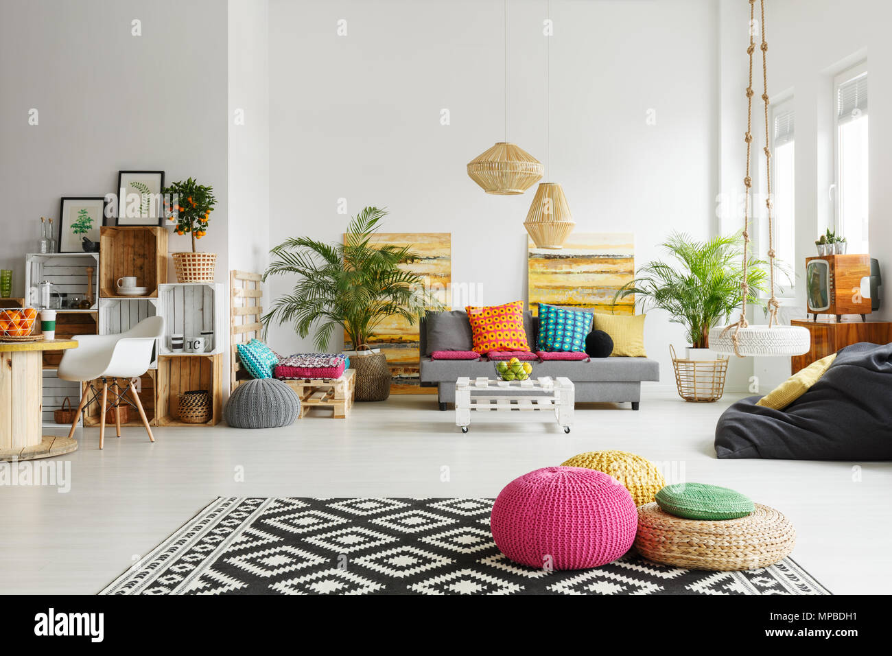 Loft Living Room With Colorful Poufs, Sofa, Carpet, Crate Furniture
