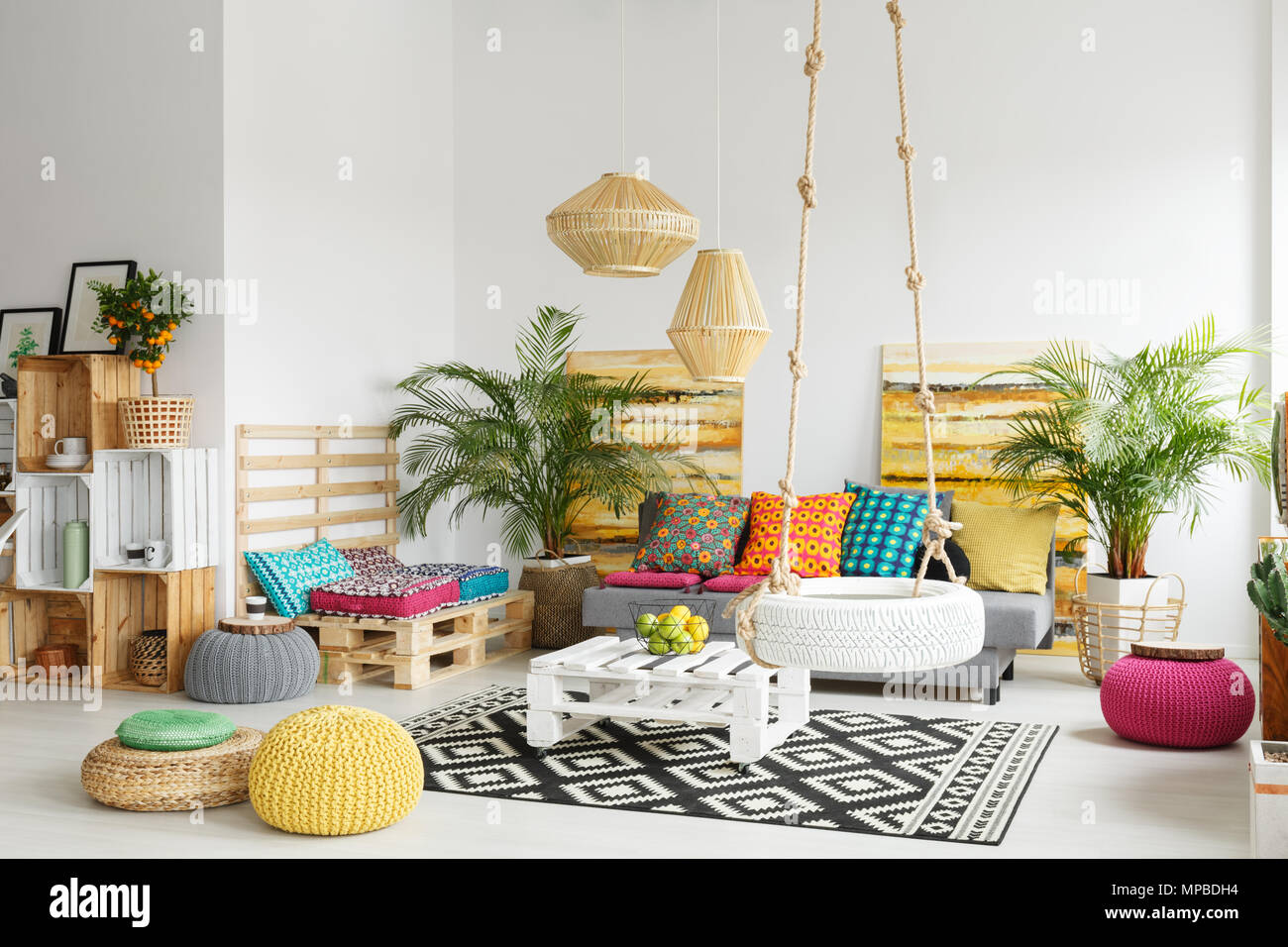 White, retro living room with pallet furniture and wheel swing Stock ...