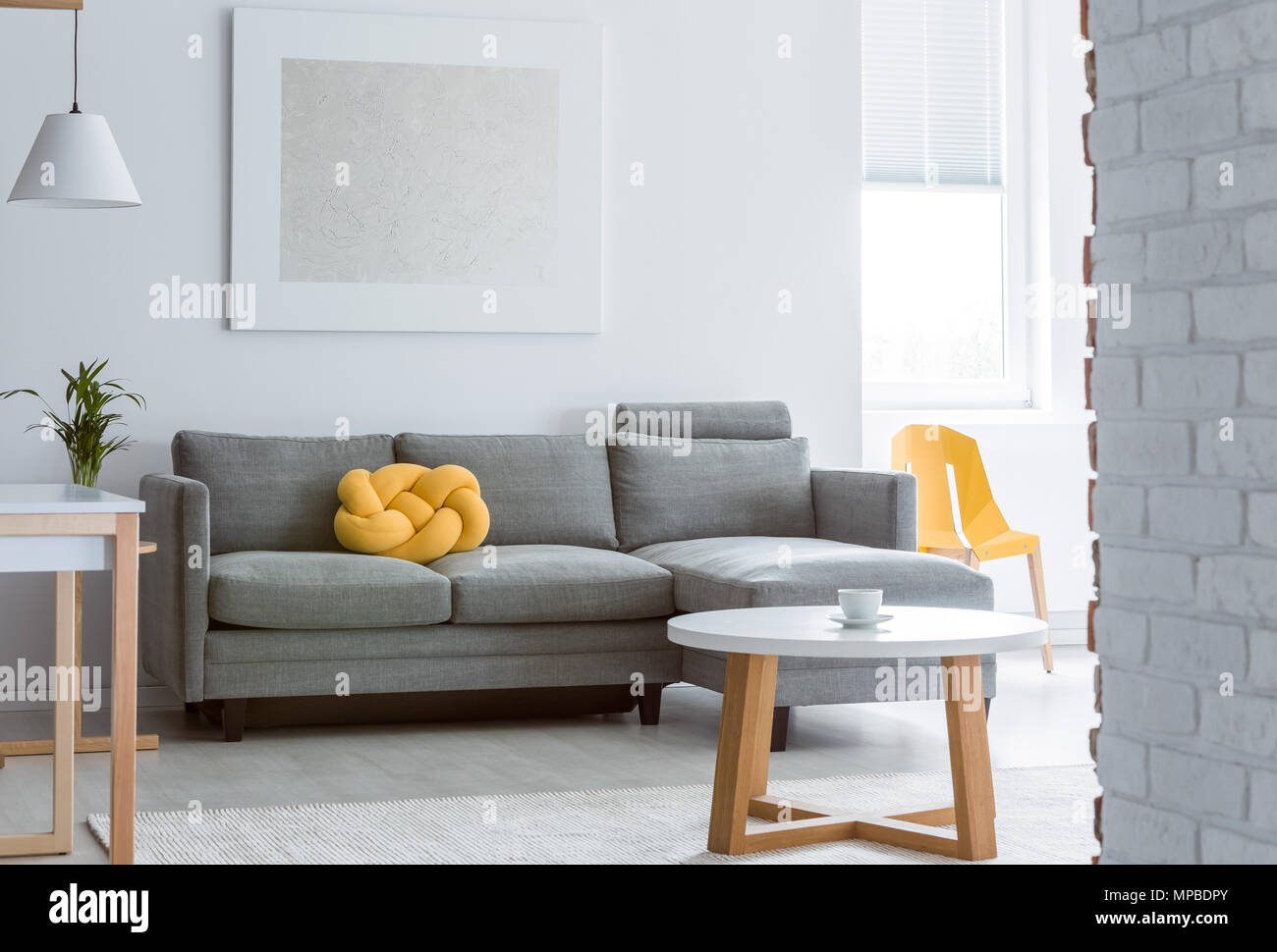 Yellow Decorative Pillow On Grey Sofa In Living Room With