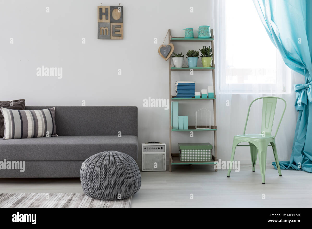 Surprising Shot Of A Bright Living Room With A Minimalist Grey Couch Machost Co Dining Chair Design Ideas Machostcouk