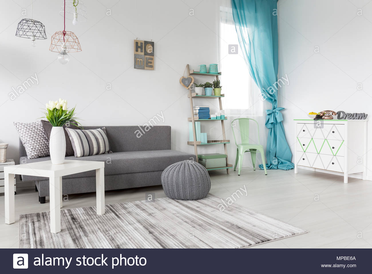 Grey Living Room With A Mint Curtains And White Walls Stock ...