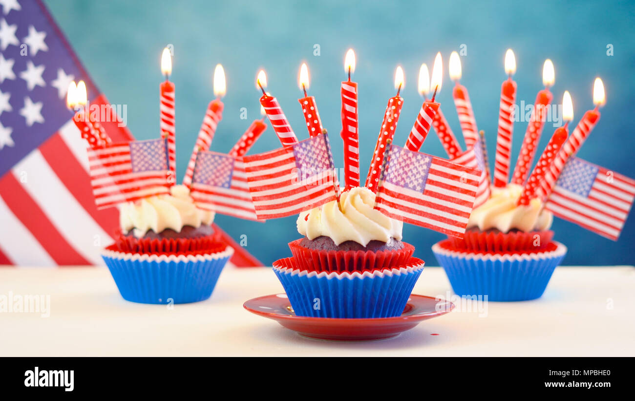 Red white and blue theme cupcakes with USA flags for Independance Day or USA theme party food. - Stock Image