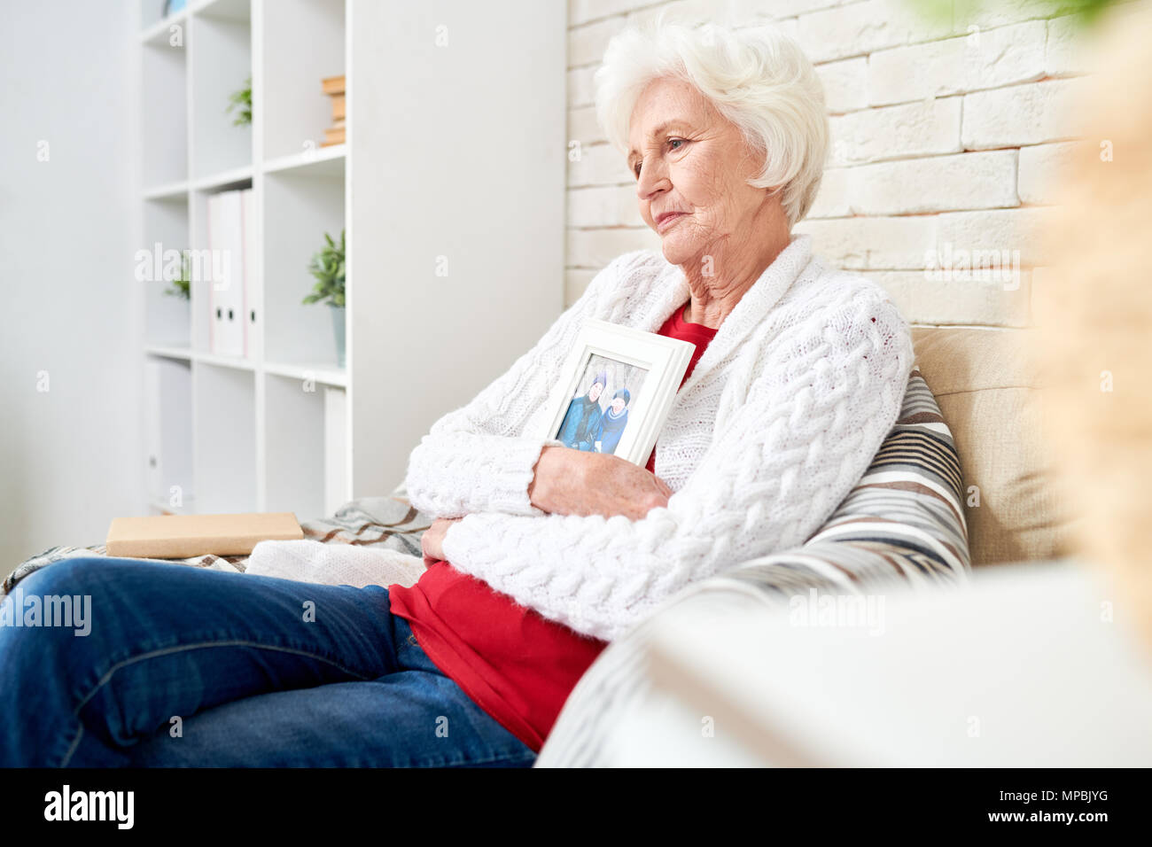 Sad Senior Woman Remembering Husband - Stock Image