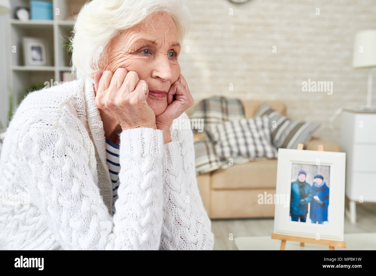 Lonely Senior Woman Crying - Stock Image